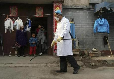 A worker sprayed disinfectant in Naidong, China, last month after a boy tested positive for bird flu in Beijing.